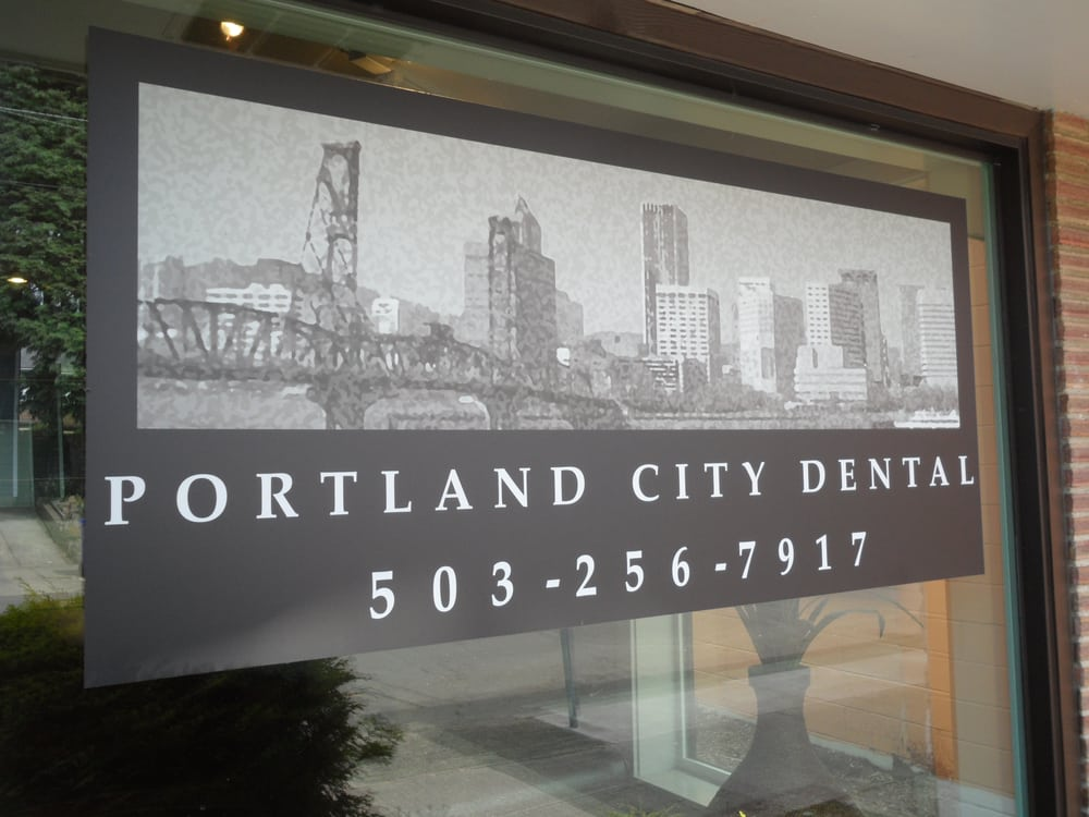 Entrance window with a poster of Portland City Dental in Portland, OR.